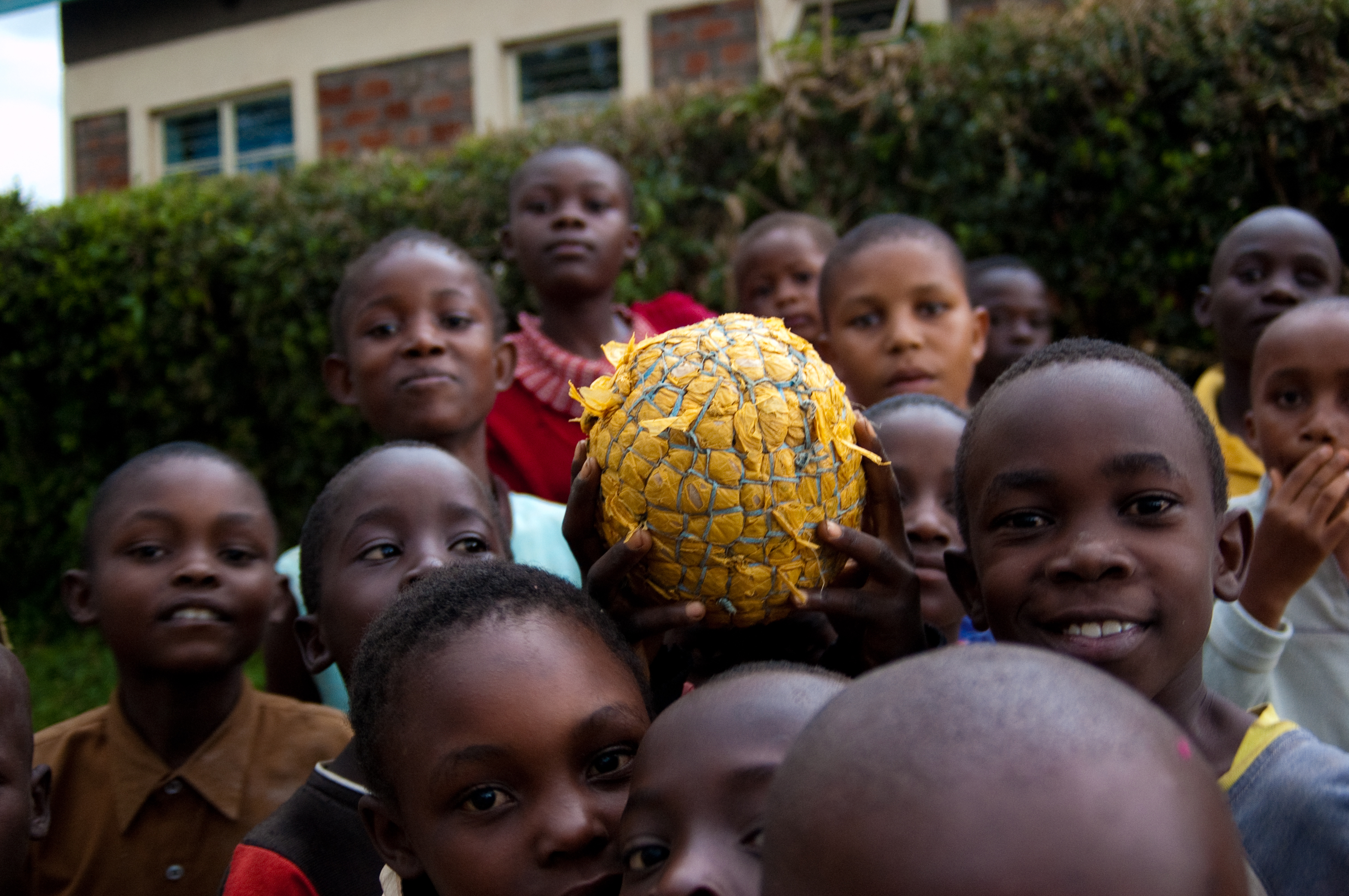 A group of children holds a ball. Photo: PATH/Teresa Guillien