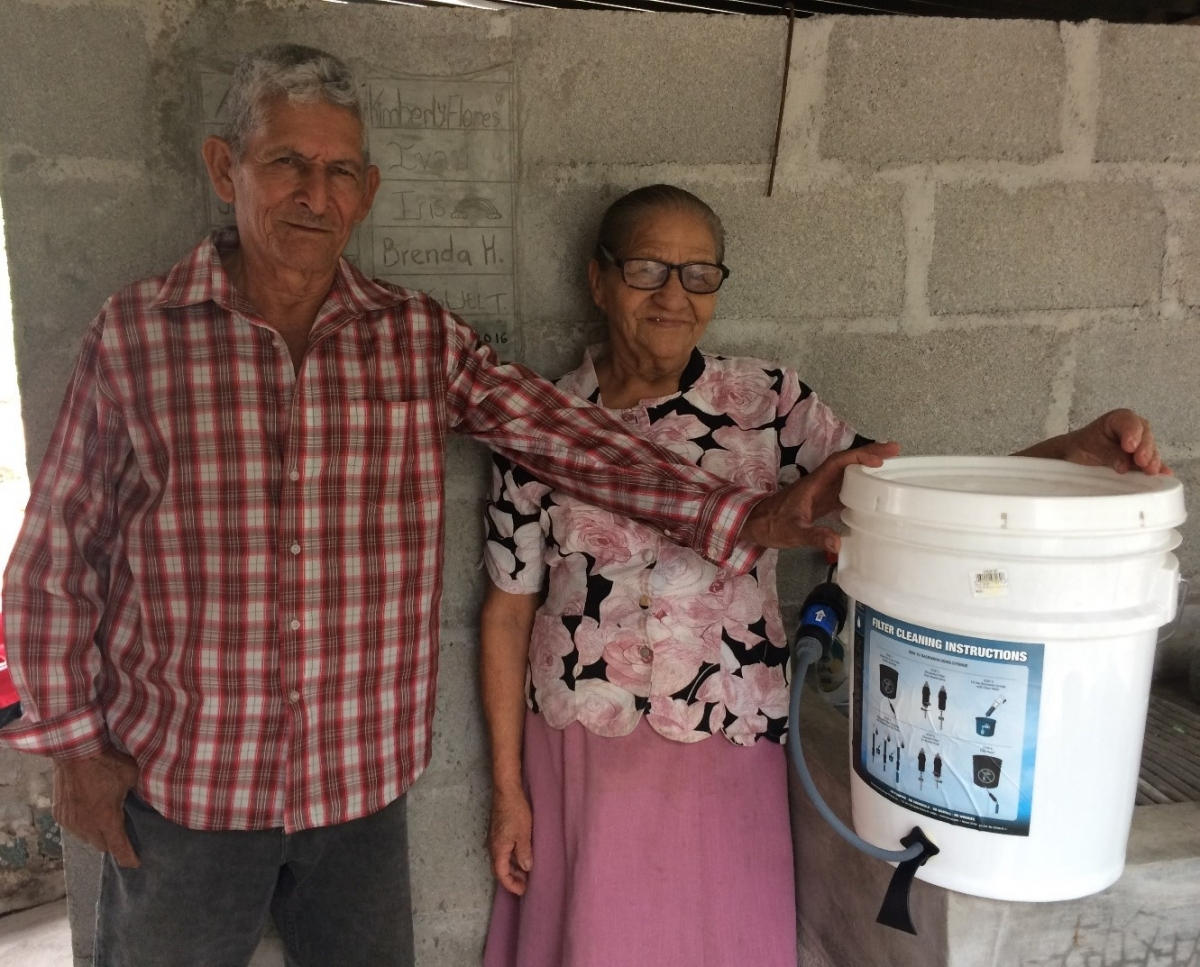 Don Bruno and Doña Adela proudly display their new water filter.