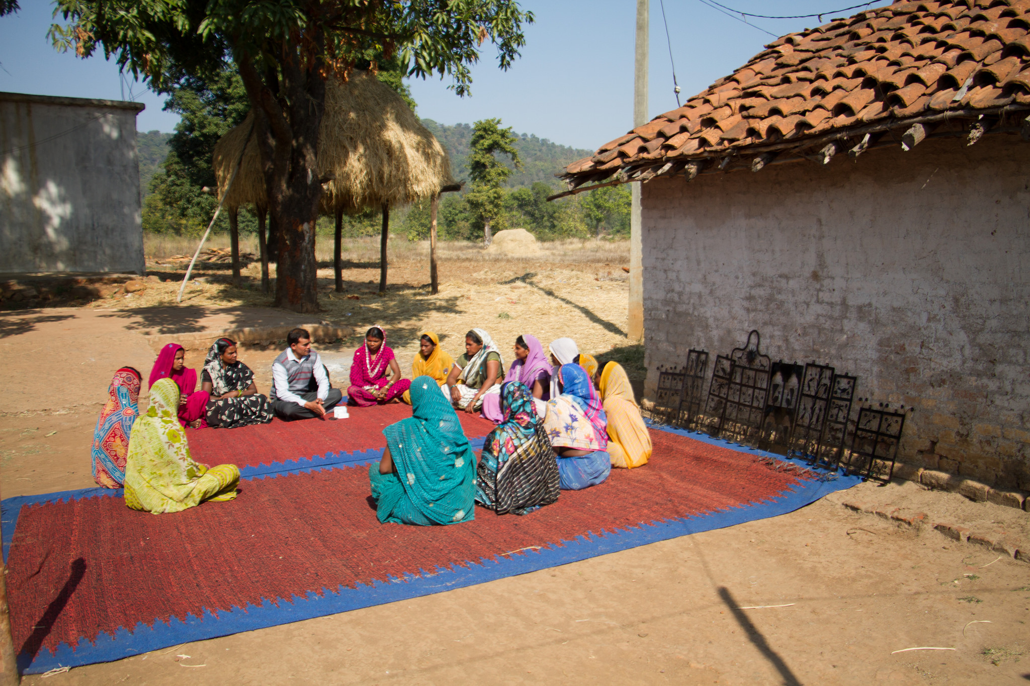 Mothers in a village, sitting in a circle at a meeting