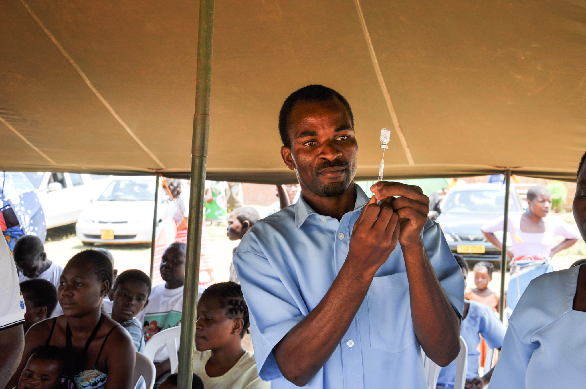 Health worker in Malawi preparing a vaccine