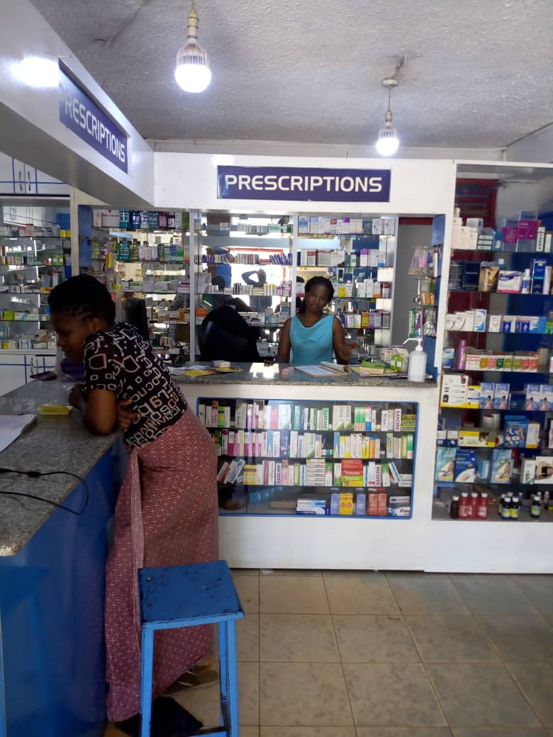 Women behind a pharmacy counter