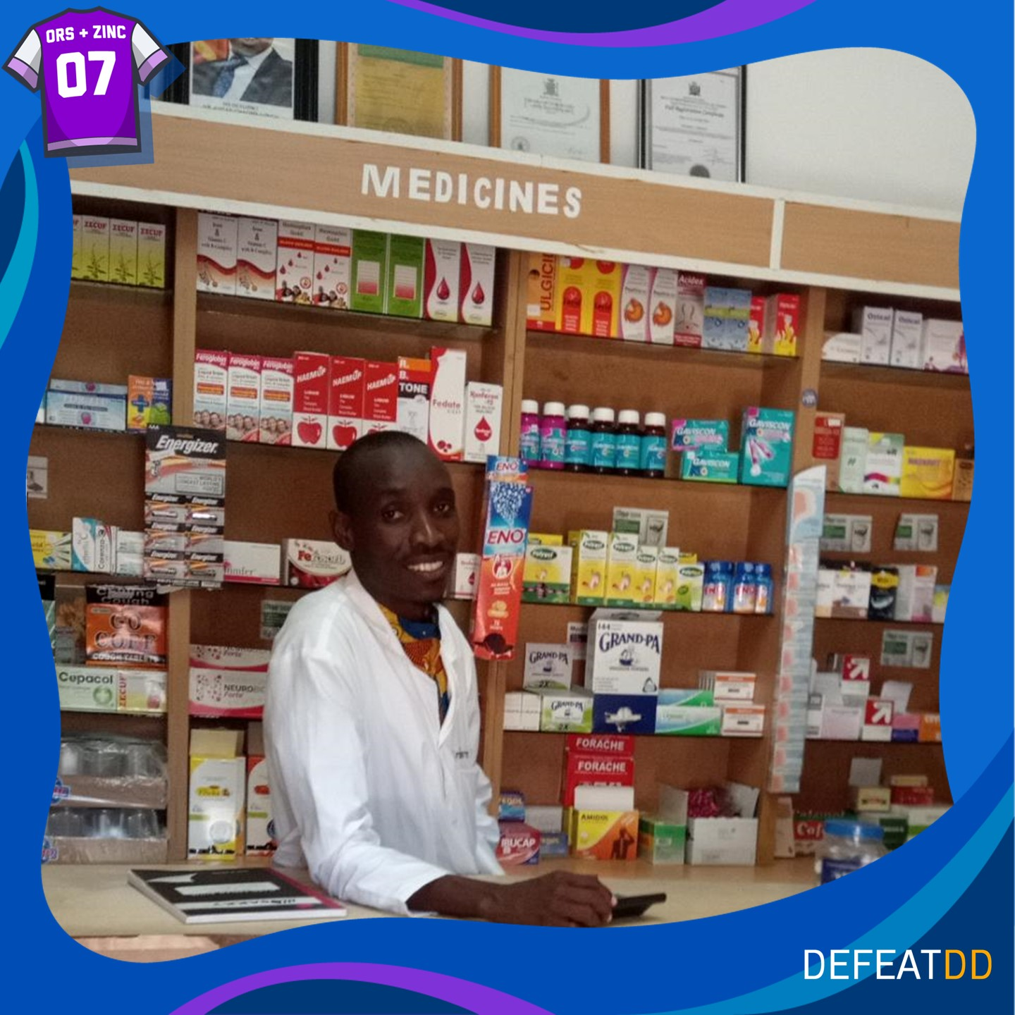 A pharmacist from Zambia smiling behind a counter