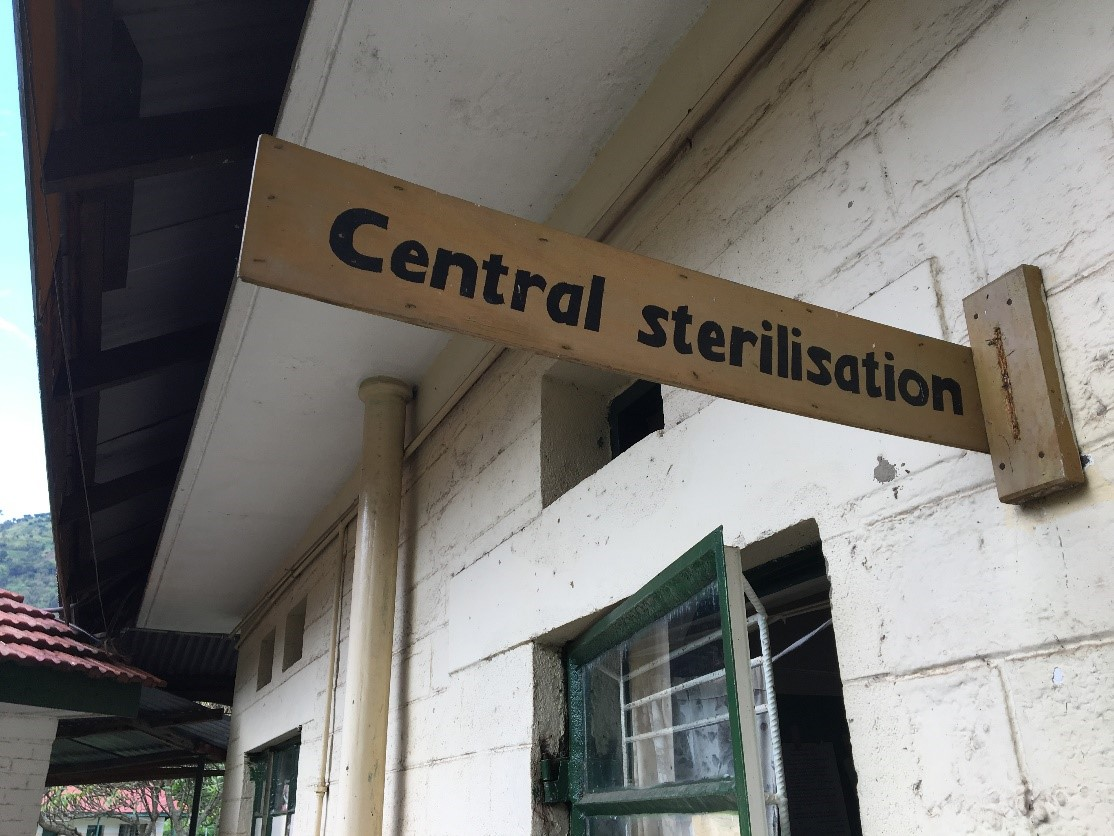 "Sign at Ugandan health care facility points to ""Central sterilisation"""