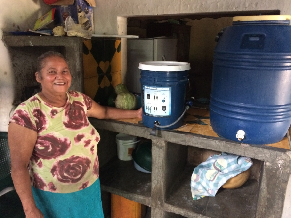 Doña Cruz with her water filter.