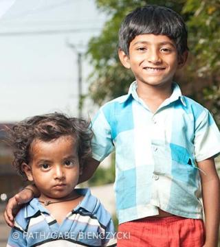 Two Indian children posing for the camera
