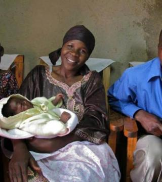 A smiling family with a baby in Rwanda
