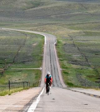 Janie Hayes rides a bike near the Colorado-Wyoming border in the 2016 Trans America Bike Race. Photo credit: Anthony Dryer.
