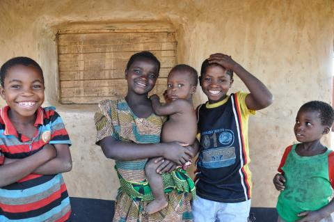 Smiling Malawian family with an infant