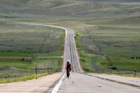 Janie Hayes on a bike on a long stretch of road