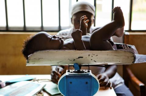 Baby is weighed on a scale at Kuje Primary Health Care Center in Kuje, Nigeria.
