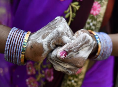 Closeup on woman's hands covered in soap. Photo: UNICEF
